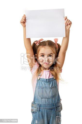 519837800 istock photo Happy cute child girl holding empty blank 1207474899