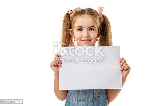 519837800 istock photo Happy cute child girl holding empty blank 1207474908