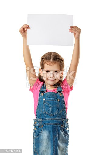 519837800 istock photo Happy cute child girl holding empty blank 1207474910