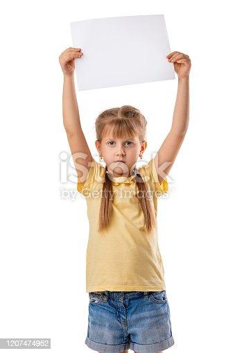 519837800 istock photo Happy cute child girl holding empty blank 1207474952