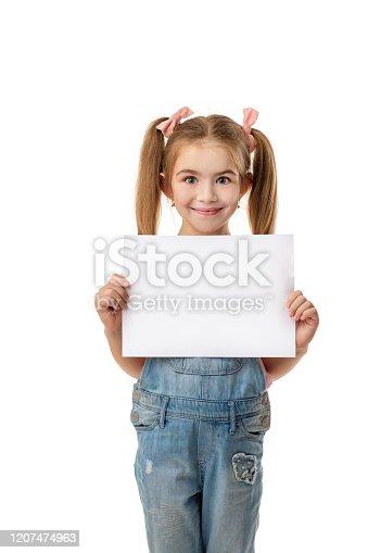 519837800 istock photo Happy cute child girl holding empty blank 1207474963