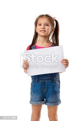 519837800 istock photo Happy cute child girl holding empty blank 1207474964