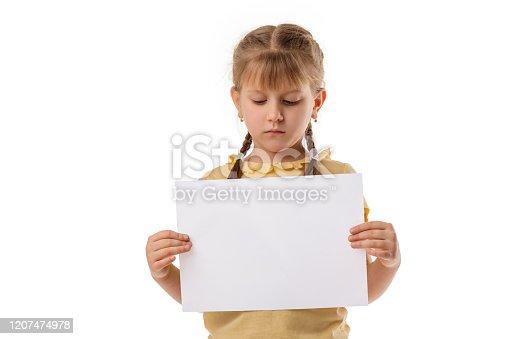 519837800 istock photo Happy cute child girl holding empty blank 1207474978
