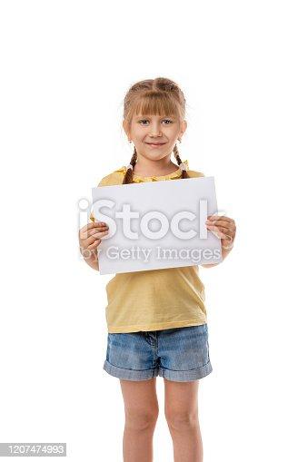 519837800 istock photo Happy cute child girl holding empty blank 1207474993