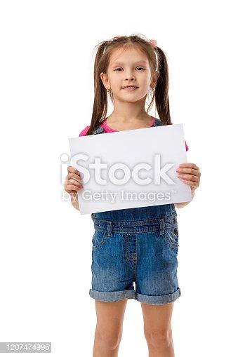 519837800 istock photo Happy cute child girl holding empty blank 1207474995