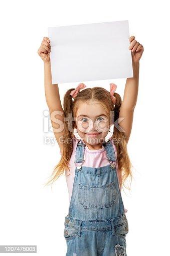 519837800 istock photo Happy cute child girl holding empty blank 1207475003