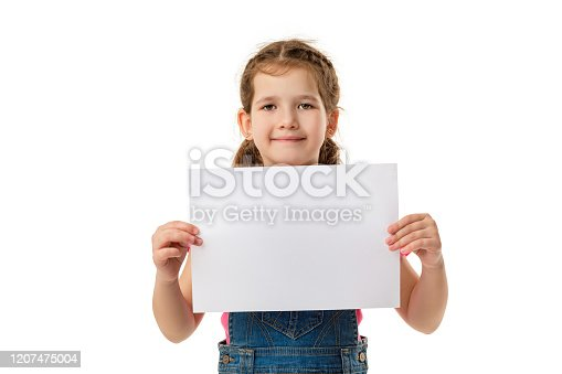 519837800 istock photo Happy cute child girl holding empty blank 1207475004