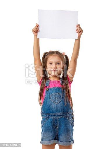 519837800 istock photo Happy cute child girl holding empty blank 1207475018