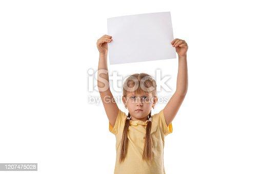 519837800 istock photo Happy cute child girl holding empty blank 1207475028