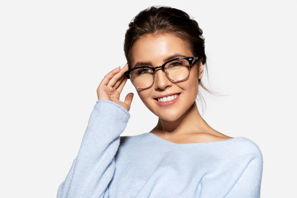Happy cute girl in glasses with perfect smile stock photo