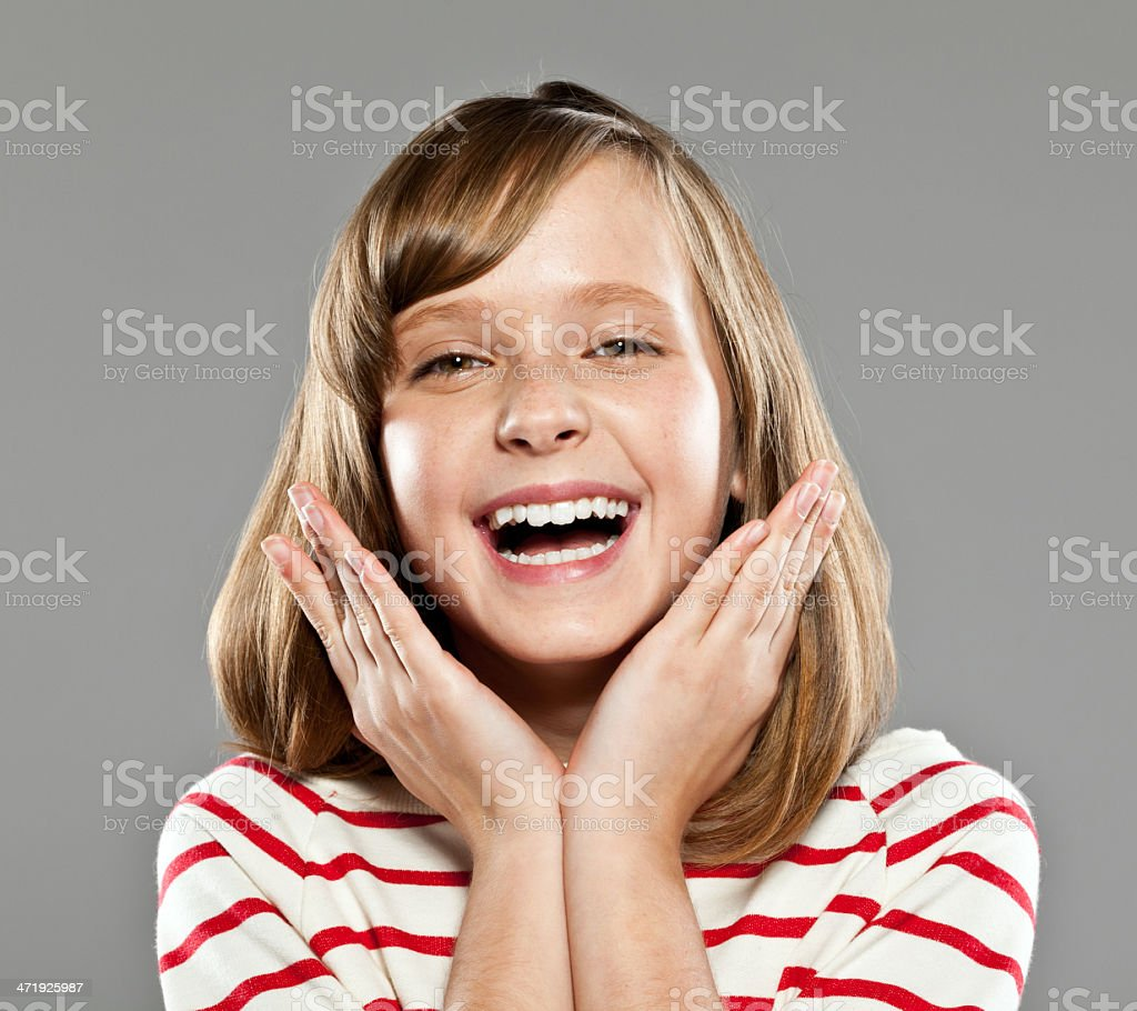 Happy cute girl Portrait of cute girl wearing striped blouse laughing at camera, Studio shot. 10-11 Years Stock Photo