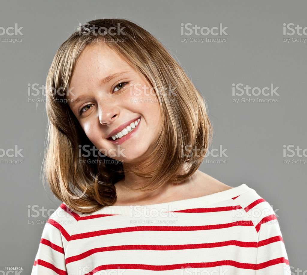 Happy cute girl Portrait of beautiful girl wearing striped blouse smiling at camera, Studio shot. 10-11 Years Stock Photo