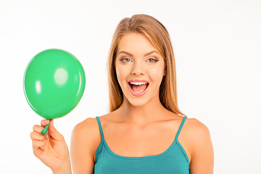 happy cute girl with green balloon smiling