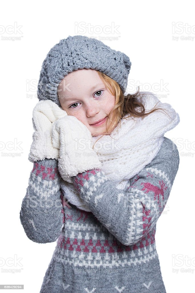 4c9f4515e Happy cute kid posing in the studio. Wearing winter clothes. - Stock image .