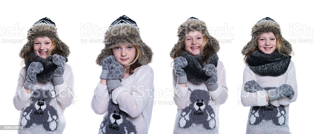 6ac7f61d6 Happy cute kid posing in the studio. Wearing winter clothes. royalty-free  stock