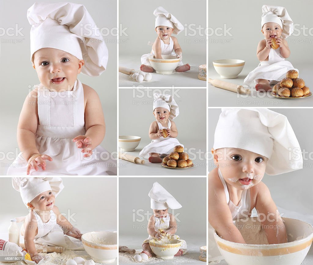 Happy cute little baby in a cook cap cooking buns stock photo