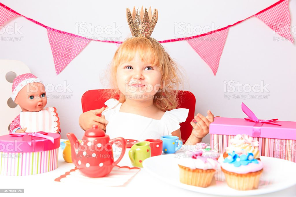 happy cute little girl at birthday party stock photo