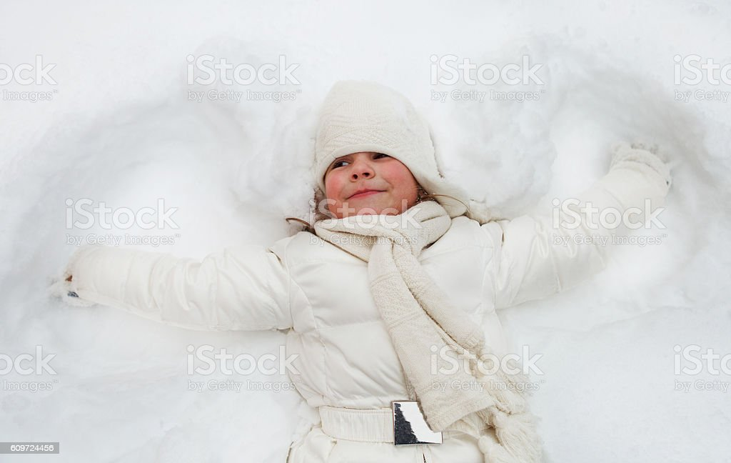 Happy cute little girl in winter park stock photo
