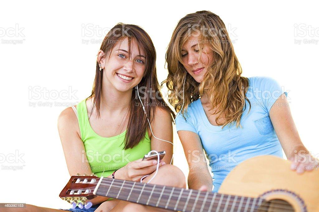 Happy cute teenage girls listening to music stok fotoğrafı