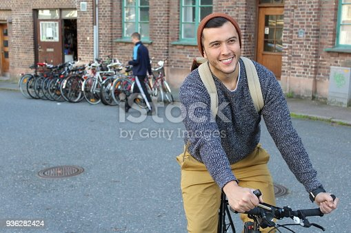 868483314 istock photo Happy cyclist in the city 936282424