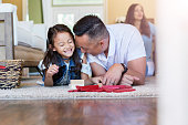 Happy dad and daughter play with blocks