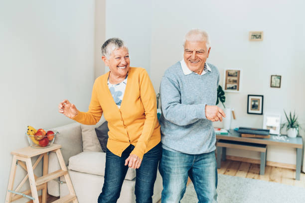 Happy dance Senior couple dancing at home young at heart stock pictures, royalty-free photos & images