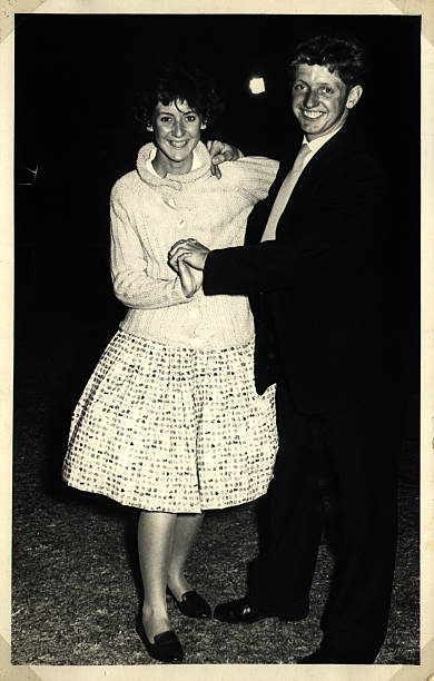 happy dancing couple - 1960s style stock photos and pictures