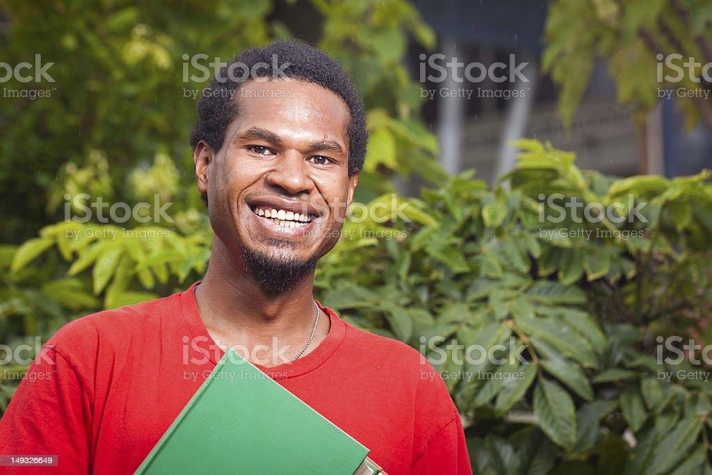 Happy dark skinned student stock photo