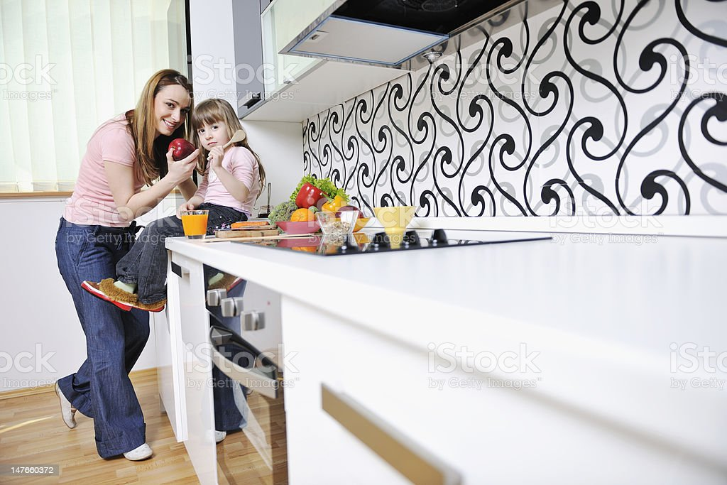 happy daughter and mom in kitchen royalty-free stock photo