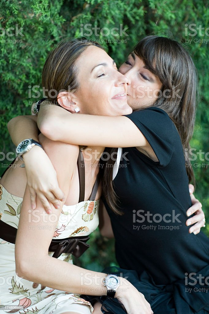 happy daughter hugging mother smiling royalty-free stock photo