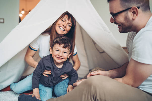 A happy day with the family Family with one small boy playing at home stay at home order stock pictures, royalty-free photos & images