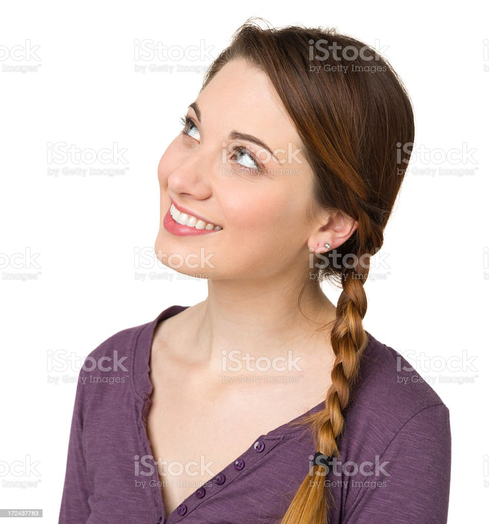 Happy Daydreaming Young Woman Looking Up royalty-free stock photo