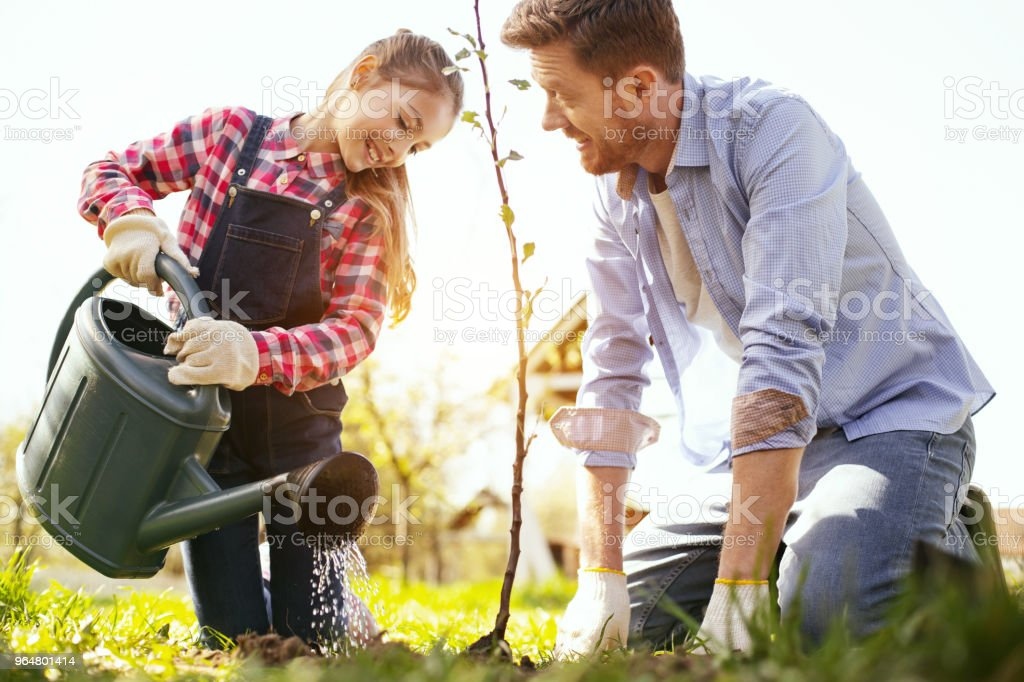 Happy delighted man looking at his daughter royalty-free stock photo