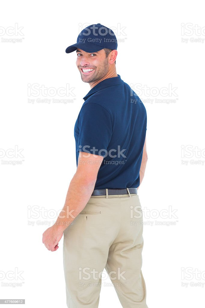 Happy delivery man wearing baseball cap stock photo