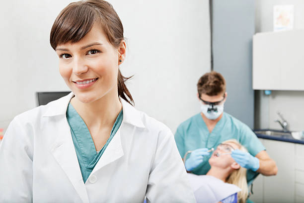 happy dental assistant - dental assistant stock photos and pictures