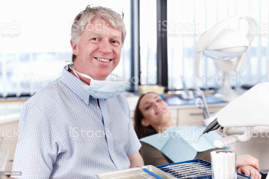 Happy dentist with patient royalty-free stock photo