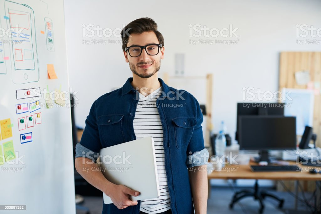Happy designer, studnet standing with laptop at office, university stock photo