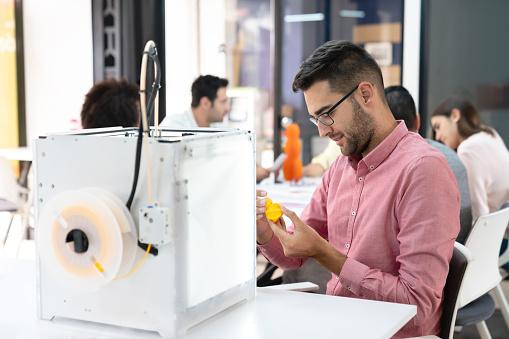 istock Happy designer using a 3D printer 1021334610