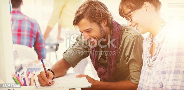 istock Happy designers working on a document 639687998