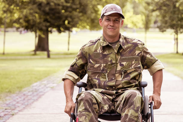 Happy disabled military man in wheelchair stock photo