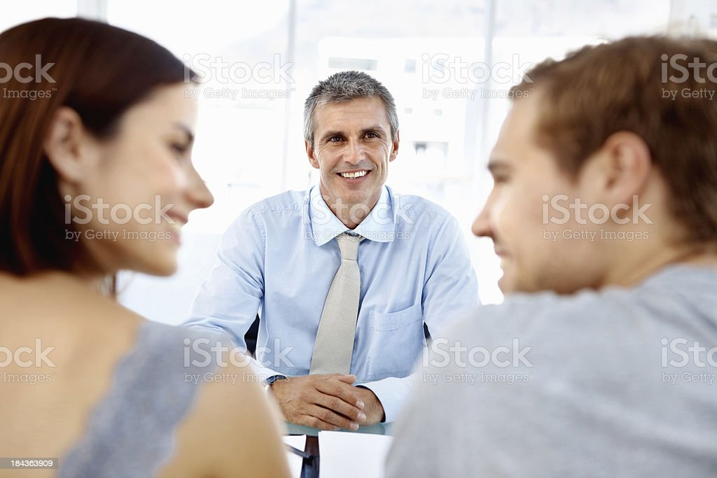 Happy discussion between financial advisor and clients royalty-free stock photo