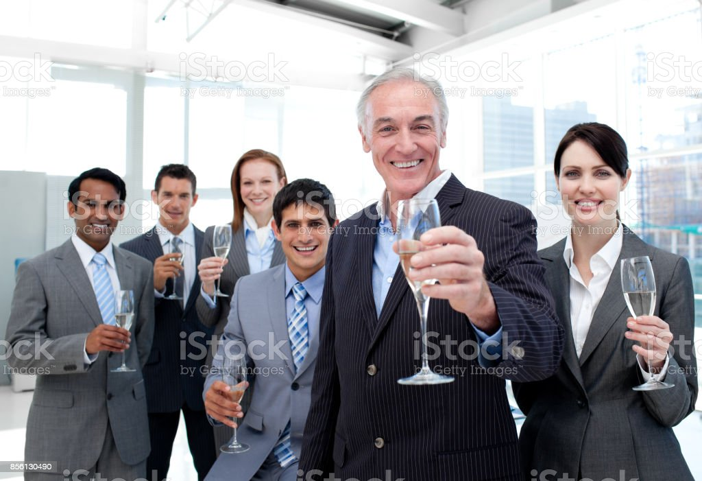 Happy diverse business group toasting with Champagne stock photo