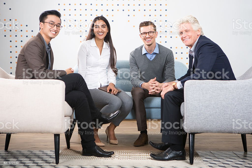 Happy Diverse Business Partners Sitting in Lounge stock photo
