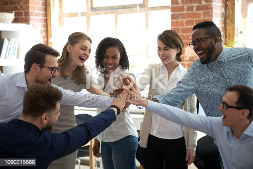 istock Happy diverse colleagues give high five together celebrate great teamwork 1090215666