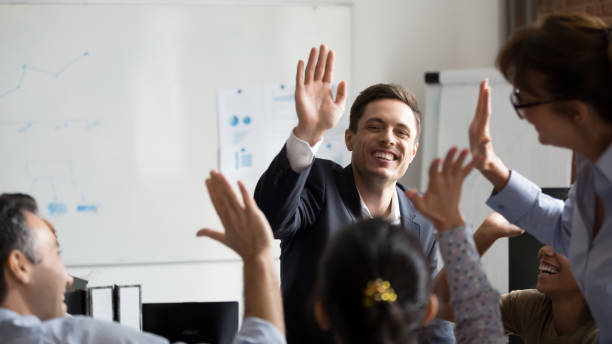 Happy diverse employees giving high five at company briefing picture id1266558137?b=1&k=6&m=1266558137&s=612x612&w=0&h=jvmlamnub6lojna1crdd3vgxfjw5jb5h fbec5f 660=