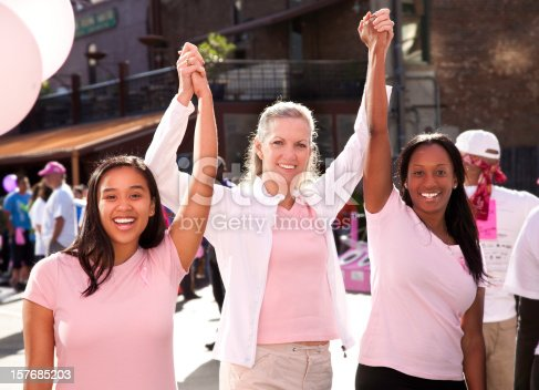 700702502istockphoto Happy Diverse Group of Women In Pink Celebrating Victory 157685203