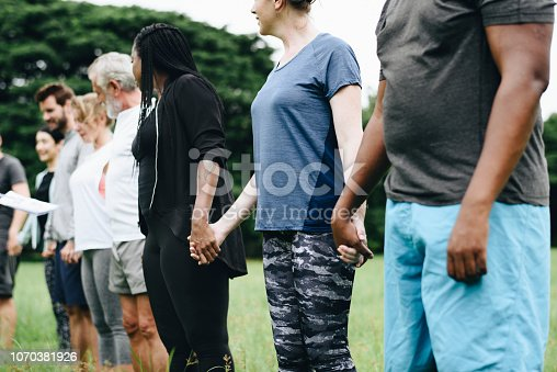 1094812112 istock photo Happy diverse people enjoying in the park 1070381926