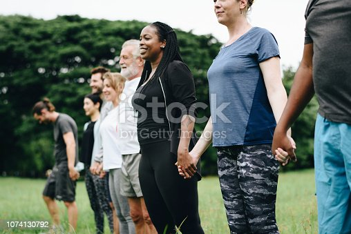 1094812112 istock photo Happy diverse people enjoying in the park 1074130792