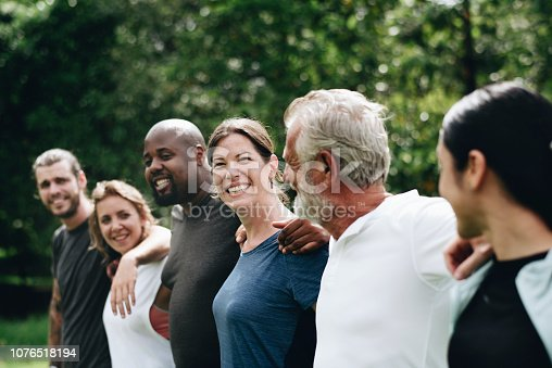 1094812112 istock photo Happy diverse people together in the park 1076518194