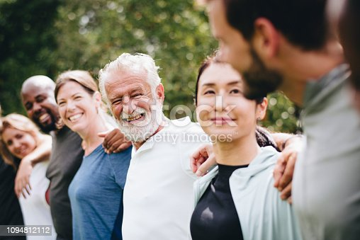1094812112 istock photo Happy diverse people together in the park 1094812112